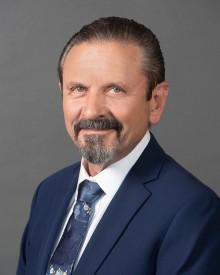 Denis E Maddox, MD